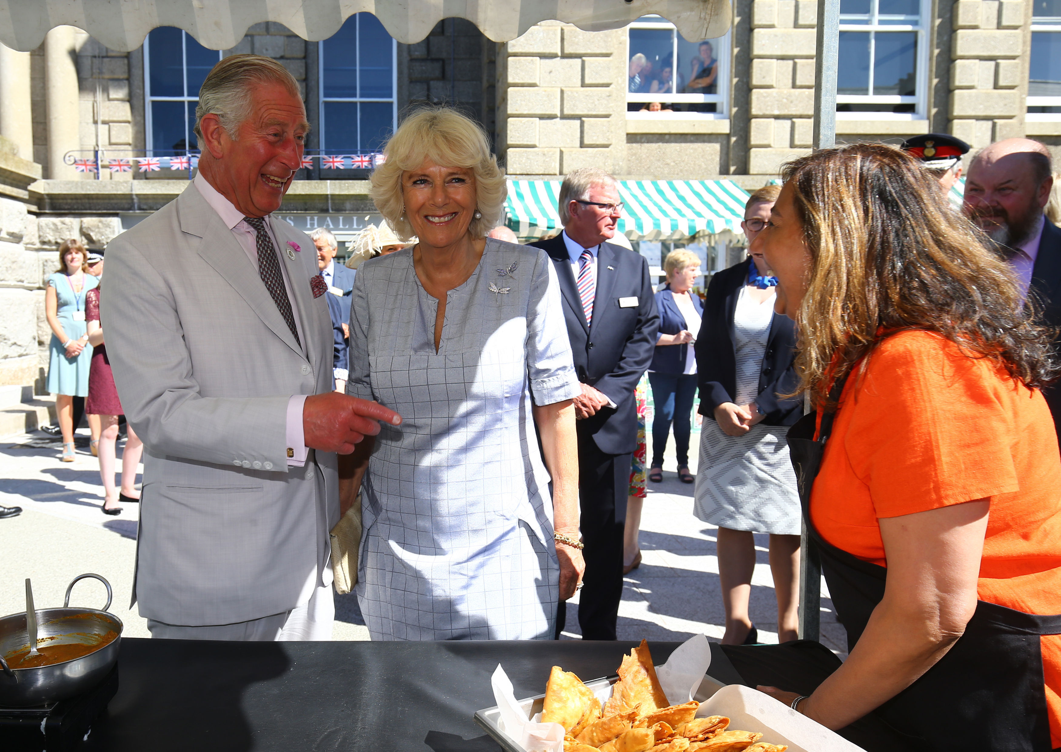 The Prince of Wales and the Duchess of Cornwall during a visit to a farmers' market outside St. John's Hall in Penzance, Cornwall, on the first day of their annual visit to the South West. PRESS ASSOCIATION Photo. Picture date: Monday July 18, 2016. See PA story ROYAL Cornwall. Photo credit should read: Gareth Fuller/PA Wire