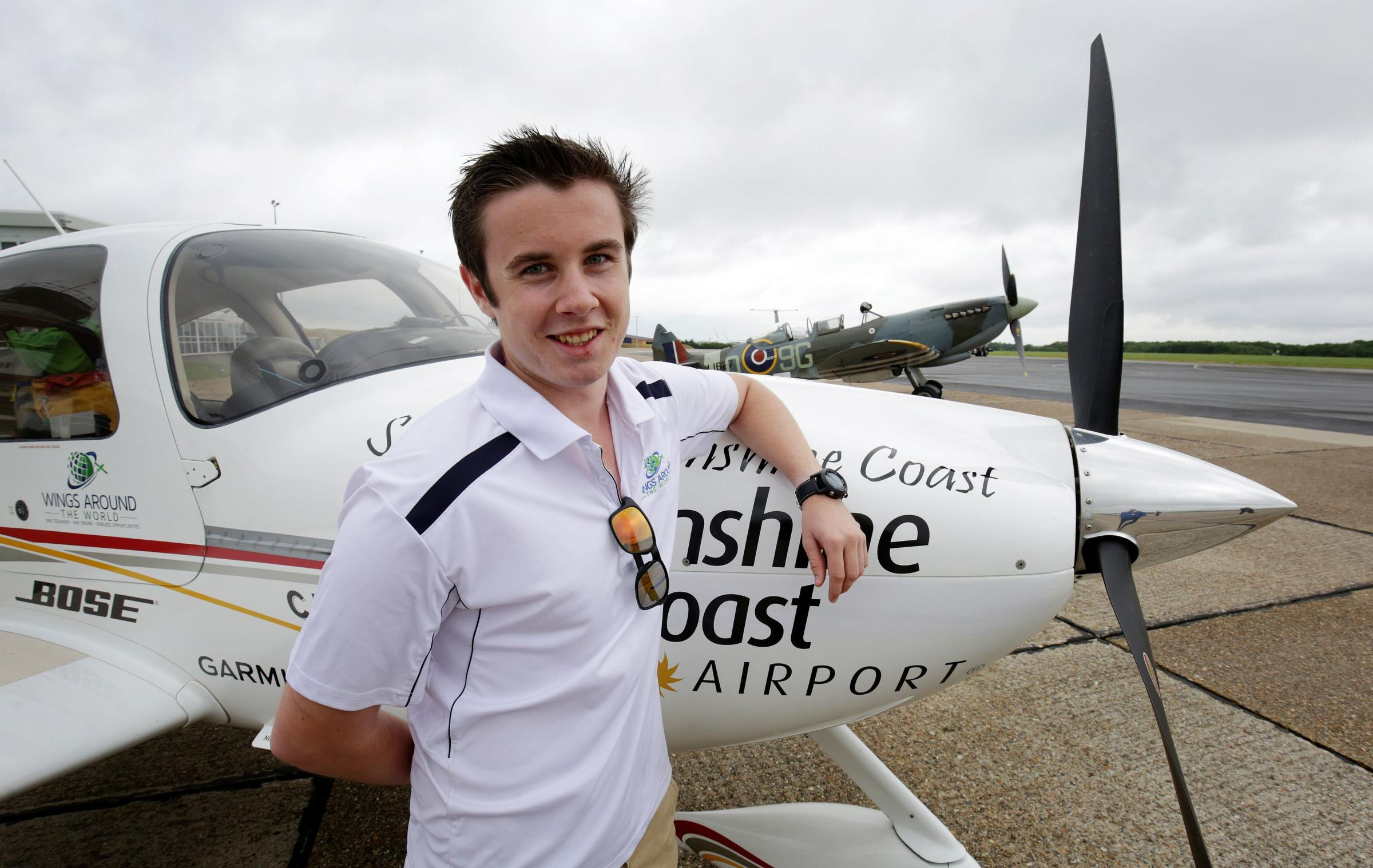 Lachlan Smart, 18, poses with his Cirrus SR-22 plane at Biggin Hill Airport in Kent, during a stopover on his eight-week, 24,000-nautical mile record bid, to be the youngest person to fly solo around the world in a single engine aircraft. PRESS ASSOCIATION Photo. Picture date: Wednesday July 27, 2016. Smart is now on an 11-day stopover in the UK after flying into Biggin Hill in Kent from the Azores, in the Atlantic. See PA story ADVENTURE Pilot. Photo credit should read: Gareth Fuller/PA Wire