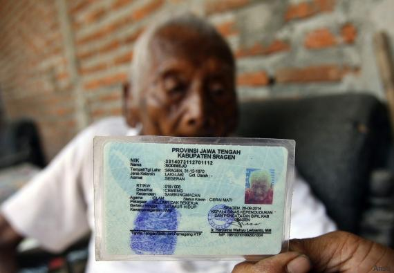 A 145 year old Indonesian man, Sodimejo, also called as 'Mbah Gotho' shows his identification card with his birth date 31 December 1870 as he sits in front of his house in Sragen, Central Java, Indonesia, 29 August 2016. Mbah Gotho is believed as the world's oldest man with documentation that stated he was born in 1870. EPA/ALI LUTFI